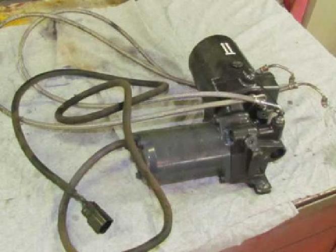 $100 OMC power tilt pump assy