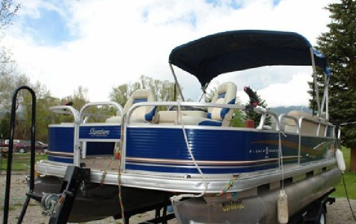 //.,,.2012 Tracker Fishing Barge DLX 20./