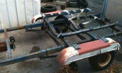 """tilt boat trailer w/ two straight axel spring suspension with shoks, roughly dim. nineteen feet x 6' 7"""" bought it to make a car trailer but never got to it, $100.00 o.b.o.for trailer as is where it is, thank you any? call ED 414-870-3747Listing originally"""