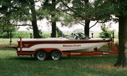 You're looking at a garage kept and adult owned 1988 MasterCraft ProStar 190 ski boat with original white vinyl interior and original red carpeting inside. Boat will include an Oklahoma City custom tandem axel trailer and boat cover. Most MC boats come