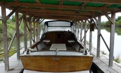 26ft Chris Craft Cutlass. ten feet beam, 3800 lbs, built in 1964, new 350 Chevy motor, gauges, and fuel tank. Everything else is original. Boat was kept in the water in a boathouse. All of the usual boat gear is included, anchors, lines, radios,