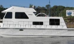 HERE'S your opportunity to get into a great late model houseboat for 1/2 of the new price! 37' LOA, 12' BEAM. LIKE NEW With an AVERAGE YEAR of USAGE, (113 ENGINE HOURS-60 HOURS ON the Westerbeke GENERATOR). THIS VESSEL WILL PROVIDE A SERENE EXTENDED RIVER