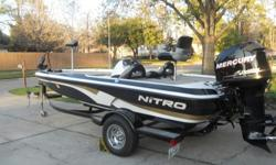 2009 Nitro Bass Boat, single console w/ Mercury 115 Optimax motor. Lots of storage, hands free trolling motor, fish finder, radio, & live well. The seats are weathered & were that way when I bought the boat. I am the 1st owner. The boat is still under