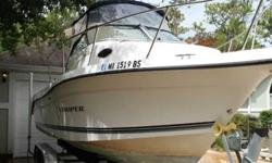 Up for sale is our 2000 Seaswirl Striper 2300 walkaround. It has a cuddy cabin and a 200 HORSEPOWER Johnson Ocean Pro motor. She is super-clean and has been babied. This boat will easily fish six people, and is perfect for trips out to the islands or even