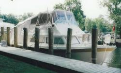 Luhrs 32x13 beam Cabin Cruiser Model 320 with flybridge Built in 1970 Twin screw, Chrysler V-8, 225hp each (gas) Fully enclosed bimini camper back (removable) Kitchen