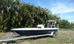 This flats boat has a re-built 150 Mercury (needs break-in period), brand-new hydrolic steering, live well, jack plate, lots and lots of storage, poling platform, aluminum trailer, new battery. Motivated Seller.
