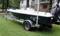 great condtion and under 100 orig hrs......boat is immaculate and ready to bass fish or flats fish or you could even bow fish with it comes with 36volt tm ,trim tabs ,pushpole , undergunnel lighting, new waterpump, compression all even at 125lb! trailer