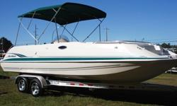 Nice 1998 Hurricane 24' deck boat in good great mechanical condition. The boat is loaded with tons of cool options and everything on the boat works perfectly. It has a huge bimini top, docking lights, ice box, built in cooler, 2 tables, porta potti, bow