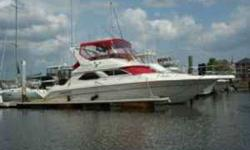 1998 Sea Ray 44 Sedan Bridge Very Comfortable Well Designed Motoryacht. A unique design feature allows for safetly walking from the large flybridge to the bow through a door on the bridge front. Steps down to the bow are railed for access to the anchor or
