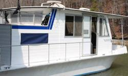 Great Houseboat. 34' x 12' Fiberglass Stardust Cruiser.. Single I/O Mercruiser which was just serviced and outdrive rebuilt. Boat runs and drives great. Just got back from 150 mile Fall Color Cruise. Accomodations include Full Pull Out Sleeper Sofa,