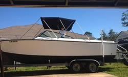 Formula 233 Thunderbird '74 with conversion bracket with an 1998 Mercury 200 outboard 2 stroke and galvanized trailer. Custom built swim platform. Floor and transom replaced in '85, and bracket installed. Compression tested, 120 psi in all