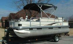 This 2006 Sun Tracker 21 ft Fish/Pleasure pontoon equipped with a 90HP Mercury Optimax outboard engine and factory matchng trailer. This is a freshwater pontoon in fantastic condition with only 41 actual running hours. The interior and exterior are very