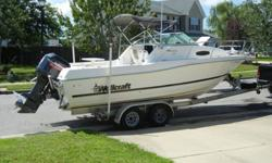 Johnson 200 HP engine (carbureted - fast response and reliable), hydraulic steering, power trim/tilt, Humminbird 787C2 color/moving map GPS/depth sounder/fish finder, VHF marine radio, Ritchie compass, dual batteries w/ switch, live bait tank, large fish