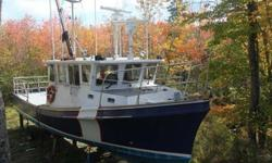 Stock Number: 704390. Solid fiberglass Northumberland Strait style hull. Pilothouse forward, with full service galley, over the engine compartment. Forecastle forward with three bunks and washroom. Work deck abaft the pilothouse over the battery locker,