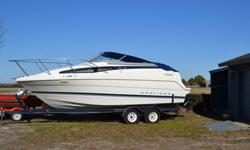 1996 23 ft Bayliner Cierra Cabin Cruiser with trailer for sale. Boat has new Mercruiser 5.7 L 210 HP engine installed by certified marine shop, new exterior upholstery, new trailer tires. Comes with a propane grill. Cabin has a toilet, stove, microwave,