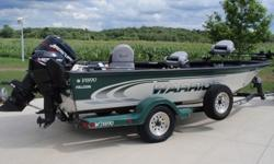 2000 Warrior 1890 BT Falcon, 90 HP Mercury with pro tiller steering and a 9.9 4-stroke kicker, Wave Wackers, Radio, Pro-Tiller Steering, Marine Radio, 3 deluxe Warrior Seats with 1 extra seat, 6 rod holders, rod storage compartments on both sides, 2 Live