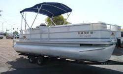 2006 Sunset Bay 230 Cruz DL Pontoon Boat by Maurell ** Low Hours on Evinrude E-Tec 75hp Outboard Motor ** Bimini Top ** AM/FM CD Stereo ** Ski Tow Upgrade ** Changing Room with Privacy Curtain ** Lots of Seating and Storage ** Tandem Axle Trailer **