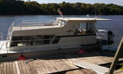 This is a rare boat, all aluminum construction. No structural wood anywhere. Built to last.Fuel efficient 302 Ford engine with Mercruiser I/O Surprisingly large interior, great window views, a simple and no-nonsense way of houseboating! Ample head with