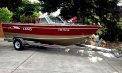 For sale Lund Aluminum fishing sport boat - 21'Powered by 5.7LLength: 21'Trailer w/breaks Fuel Tank 1 (about 80 Gallons)Bimini topRod holders 1RF18561351031988 Auto/manual pump live well's for fish (2). Lowrance Fish finderJust serviced engine, oil, and