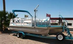 Supercharged Mercruiser 350 Mag, Alpha One, Through Hull Exhaust, Large Front Deck, Electric Davit w/ 2 Mounts for Hoisting Jet Skis, Extended Rear Swim Step w/ Ladder & Gate, Galley w/ Sink, 2 Tables, 2 Upright Coolers, Fish Finder, AM FM Cassette, Ski