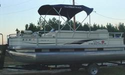 This 2005 Sun Tracker Fishing Barge is LIKE NEW, with a 90 HP Mercury Motor, plus Trolling Motor and original trailer. It has a Bimini Top, Fold down swim ladder, front and rear live wells, depth finder and fish finder, removable table, marine radio with