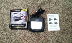 Terrific shape 6 amp battery charger. Has three charge cycles including trickle charge. Call