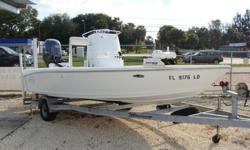 2006 Yamaha 4-stroke with 252 hours since new, hydraulic jack plate, Minnkota trolling motor 80 lb thrust 24 volt, onboard battery charger and battery switch, Minnkota Talon power pole, Humminbird fishfinder 160, Ritchie compass, Ice cooler, Magnum