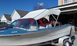 """I have a 60""""wide bimini top and windshield.The top is white and grey and in great shape.The windshield will need to be polished,but the snaps are there for the top.$160.00 for the pair.Pat(208)262-9040"""