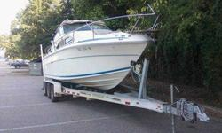 Sea Ray, cozy cab, V-Hull boat in great shape along with a BRAND NEW TRAILER, practically never used, for sale. Boat body and interior in great shape. VERY LOW HOURS! Sleeps 6 with two berths, and someone can sleep up as well if necessary. Refrigerator,