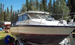 VERY VERY CLEAN low hours on 2159 Bayliner. Loaded with factory options. Nice cuddy. Table makes bed. Sink, two burner stove, Frig/icebox, Windlass, trim tabs, cabin heater and drive trim. Teak alaskan bulk head separates cabin from cockpit. very nice all