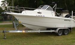 210 Walkaround, 150HP Mercury Optimax Saltwater Series, full service just completed including water pump,etc., low hours, One Owner-all books and records, Magic Tilt Aluminum dual axle trailer with brakes and new spare tire, livewell, bait tank, new porta