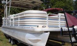 If you are looking for a nice, older, less expensive HUGE pontoon boat that is loaded with cool options and in great shape with LOW hours, look no further!!! This 26 foot pontoon boat comes with a vinyl floor with snap in carpet, dual driver's helm seat,