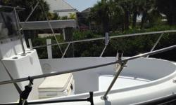 17' Boston Whaler Outrage 1996, center console 150 Evinrude direct fuel injection, trailer, bimini, full cover, helm and seat cover, full cushion package, GPS/Depth finder, bait well, excellent condition. $12,500, Lift kept. Great Unsinkable Fishing