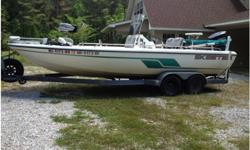 2001 Skeeter ZX2200T, center console powered by Yamaha VX225 3.1 L, V-6 with 96 hours. Includes fore and aft pedestal seats, a lean-on seat, a bait-cutting station, a Bimini top, rear jump seats, power trim and jack plate, Motorguide 24 v. trolling motor,
