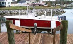 Fresh or Saltwater Fishing Boat in Excellent Condition!!! HPDI-T-top, Rocket Launchers, Leaning Post, Spreader Light, Bolsters, Swim Platform, Compass, S.S. Prop, Lenco Trim Tabs, Full Guages, Two Live Wells, Portipotti, Garmin GPS, Chart Plotter, Marine