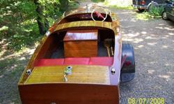 1947 Chris-Craft Special Runabout -Restoration completed 2010. Factory style bottom (caulk and paint)completely redone (stripped, decaulked, screws tightened/replaced, sanded, caulked, sealed, primed, & painted). 1947Chrysler Ace engine, completely
