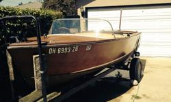 Here is your opportunity to own an antique wood boat. This is a 1958 Chris Craft with a in line 6 Chris Craft Marine Engine. The bones of the boat are in good shape and is complete. This boat does need work. If you are looking for a restoration project,