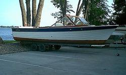 Perfect for big water day cruising - 28 Sea Skiff. Twin engines (350/ 260 hp).Completely rebuilt in 1998, including engines and electrical, new bottom in 2005.1998 Rebuild included -new decks, new vinyl covering, new chrome, new rub rails, mahogany hull