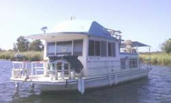 36' Gibson Houseboat.We purchased this boat to live on, then decided it was too small for our family and children. Our loss is your gain. ** Well equipped:- Twin Gasoline 350 Engines- 3 Solar panels with inverter- 6.5 KW Onan Generator- Refrigerator- Air