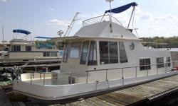 1972 37 FT Boatel Tradewinds with flybridge.Recently updated interior on floors and walls. Sleeps 6, 2 in front cuddy, 2 on Futon, and 2 on table that converts to a bed. Also has a sleeper sofa in back. Plenty of storage in cupboards, closets, and storage
