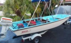 The 2B series are TAN interior in color. REMARKABLE original condition. Has had touch ups in both blue interior and hull as expected in 41 year old boat. Wood original and recently teak oiled. Front hatch area wood might be replacement. Trailer recently