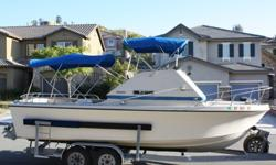 24 Fly Bridge, professionally installed fresh water cooled 320 Horsepower factory new High performance Marine Vortec engine (not a Chevy truck engine like most 24?s) with 768 total hours, new hoses and belts, new water pump, new exhaust manifolds and
