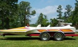 """HONDO 1979 JET BOAT WITH TRAILER .--BOAT LENGTH: 18' 1""""--JET LENGTH: 2' 1""""--ENGINE: 504 Cubic Inch -Chevrolet--Dual 850 Holley Double Pumpers--Tunnel Ram Intake--Oval Port Aluminum Heads--Carburetors have just been reworked--Donovan Jet - Jetavater,"""