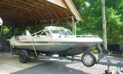 Silver metallic finish, seating for 8. New parts include: trailer tires, battery, gas tank, steering cable, floor. Stainless steel prop. Engine has been completely overhauled. Included is fish finder, life vests, 2- anchors and storage cover. Kept in