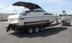 The hull of this boat is in overall outstanding condition. The paint is very nice, no big scratches or cracks. The fiberglass is solid as is the transom, deck and all else. The bilge, upper and lower decks are in great shape. The windshields are without