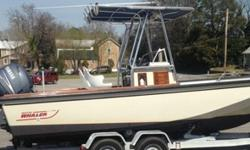 1984 Boston Whaler Outrage 22 and dual axle trailerEngines - twin 4-stroke 115hp Yamaha engines with approx 150hrs each - serviced by a Yamaha Certified Master TechnicianPropellers - Stainless steel propellersAll original teak wood and bright work on