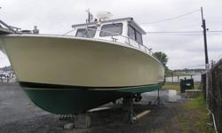 """1984 Uniflite 36 Charter BoatHULL IS A 1984 1995 430HP VOLVO DIESEL 40 HRS. SINCE MAJOR OVERHAUL . BOAT IS A FULL WALKAROUND BUILT FOR THE NAVY BY UNIFLITE. KEVLAR HULL 2- STAINLESS FUEL TANKS 100 GAL. EACH HAS 2 NORTHSTAR 6000I 10 """" CHART PLOTTERS ,"""