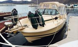 Stock Number: 720578. Vintage Beauty!!! Fully restored 1985, Chris Craft 216 Scorpion Skiing/Fishing Boat!, Walk around bow, Cuddy cabin, 225 HP V6 Ocean Runner Outboard, 6.9 Mercury trolling motor, with less than 100 hours, Keel Protector, New Striping,