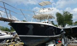 ,,...28' Blackfin Tuna boat powered by twin 250 HP Evinrude E-TEC motors with less than 300 hours on them.Furuno electronics including depth finder, fish finder and 2 GPS'. New upholstery. In the water now.Has gin pole and out riggers, a small cabin with