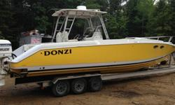,,,,,,,,,,,,,,This is a 33 foot DONZI CENTER CONSOLE that is ready to go in the water, strong hull ,fresh water boat , no bottom paint and hull is real nice , Hull is 1988 And was redone in 1998 as well as engines are both twin counter rotating 225 HP